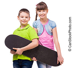 pretty children holding skateboard in hands