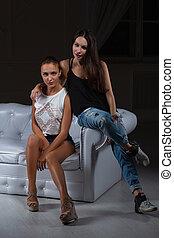 Two pretty girlfriends posing in the studio.
