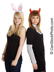 Two pretty girls in costume rabbit and devil