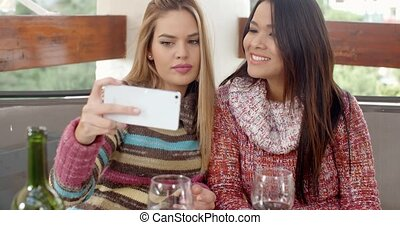 Two Pretty Girls Taking Selfie at the Cafe
