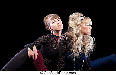 Two pretty sisters posing in lace costume