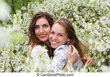 Two pretty smiling women