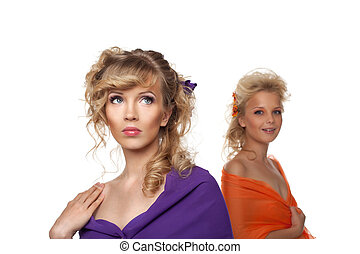 two pretty woman with flowers in hairs