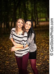 autumnal forest - two pretty women in a autumnal forest