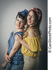 Two pretty young women in retro clothing