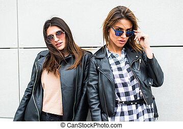 Two pretty young women with sunglasses