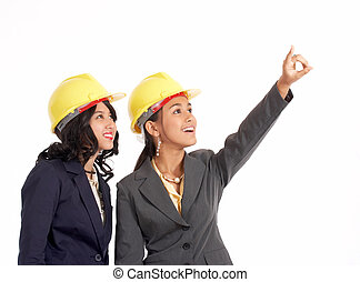 two professional draftswoman looking up and pointing