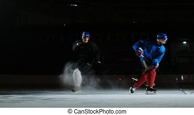 Two professional hockey players go to Luda in the fight for...