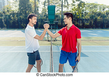 Two professional tennis players shaking hands as a gesture of fair play