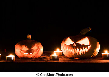 Two pumpkins are on the table, and candles are burning around. Halloween art design