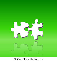 two puzzle pieces on green background