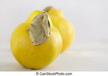 two quinces on ceramic background