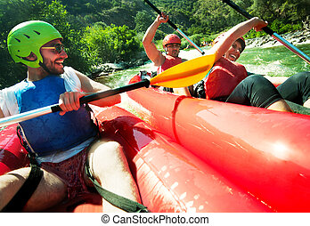 Two rafting canoes collision - Two red inflatable canoes...