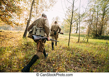 Two Re-enactors Dressed As Russian Soviet Red Army Soldiers ...