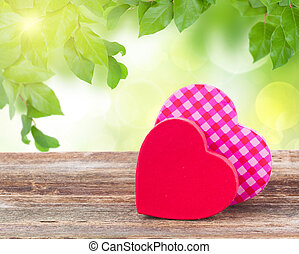 two red and pink hearts - pair of red and pink hearts laying...
