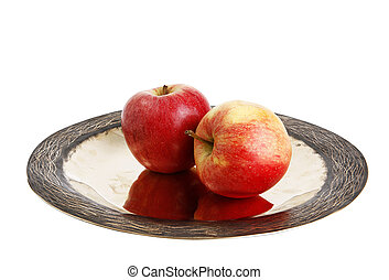 Two red apple on plate