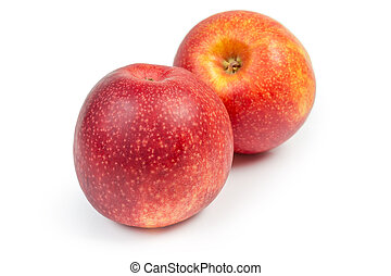 Two red apples on a white background at selective focus