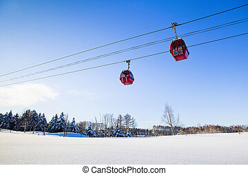 two red cable car in winter