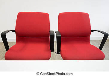 two red chairs in office