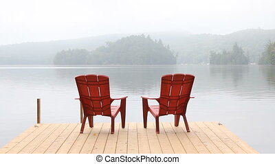 Two red chairs on dock.