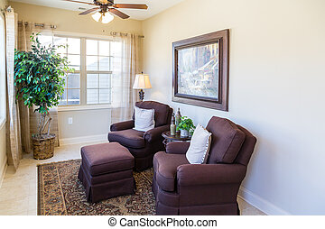Two Red Chairs with White Pillows
