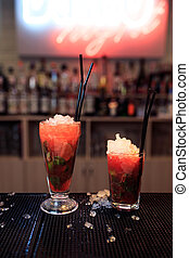 two red cocktails with ice