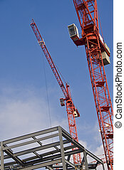 Two red cranes