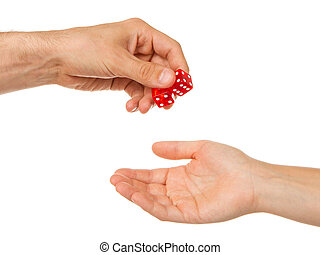 Two red dice being given, man to woman