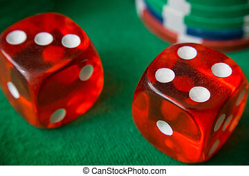 Two red dice fall 7, casino chips, cards on green felt