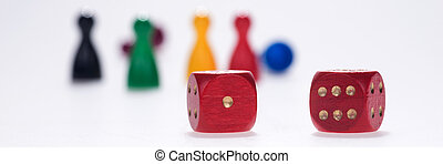 Two red dice with board game figures