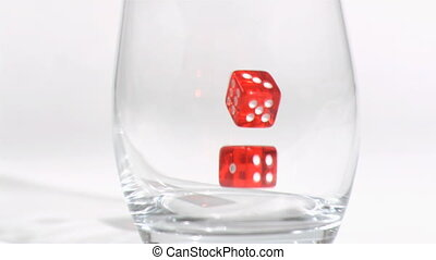 Two red dices  in a super slow motion rebounding in glass