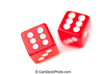 Two red dices in motion against a white background