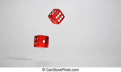Two red dices  in super slow motion turning
