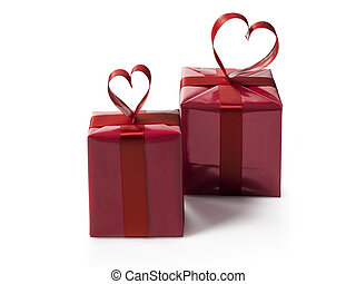two red gift boxes with red hart shaped ribbon bow