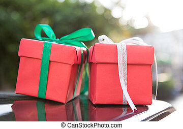 Two red giftbox with flare