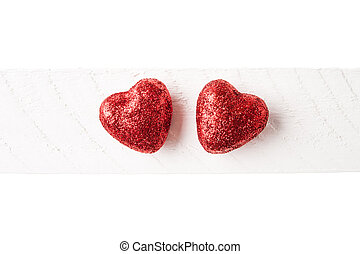 Two red glitter hearts valentines day background