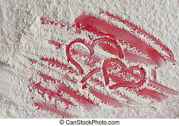 Two red heart on flour background, top view