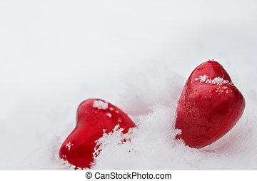 red hearts in the snow