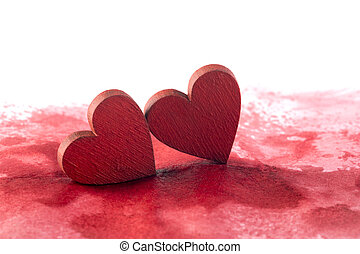 Two red hearts on a bloody background