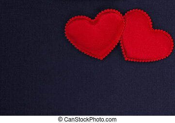 Two red hearts on a dark blue background. Valentine's day