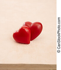 Two red hearts on Pink background