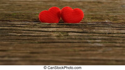 Two red hearts tuck on the wooden plank 4k - Two red hearts ...