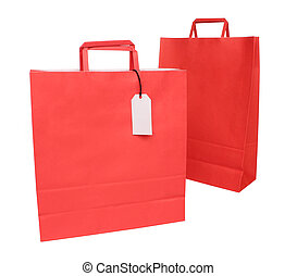 Two red paper shopping bags over wh