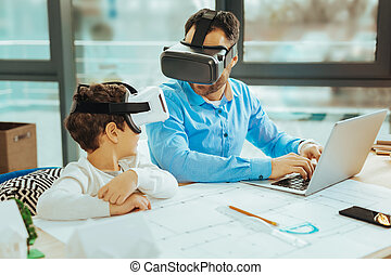 Two relatives sitting together and staying connected in virtual reality