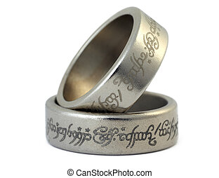 Two rings of porous silvery metal with arabic ligature...