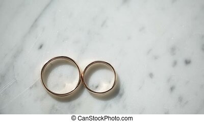 Two rings on marble background