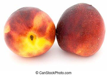 Two ripe nectarines