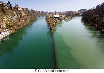 Two rivers junction, the Rhone and the Arve, in Geneva,...