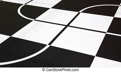 two robot toy cars moves along intersecting lines drawn on large chessboard