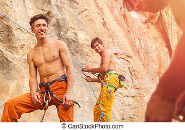 Two rock climbers on the cliff